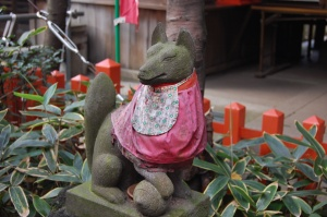 This red bibbed fox is the guardian of the Inari shrine