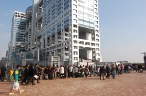 The crowd on the bridge overlooking the Fuji TV building